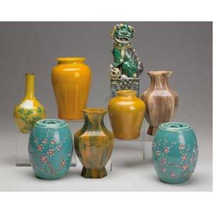 Asian pottery grouping of eight pieces chinese bottle vase painted with peonies three vases all with base or rim chips foo dog 20th c two barrelshaped covered jars purple vase marked china t
