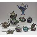 Cloisonne miniature teapots grouping of ten in shades of blue green and black most late 19thearly 20th c tallest 6