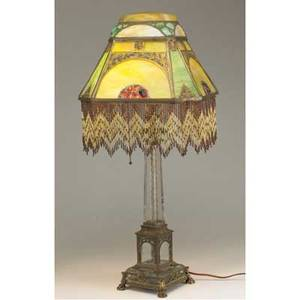 Moe bridges lamp leadedglass shade with eight panels domed top and beaded fringe the base with clear glass and bronze mounted signed base damage to glass in base ht 31
