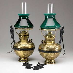 Bradley  hubbard pair of electrified wall sconces with green cased glass shades and wall brackets late 19th c 12 x 14