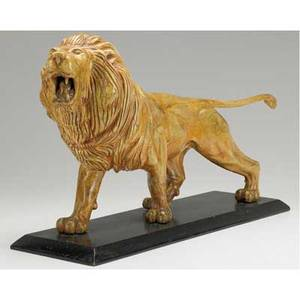 Folk art wood carving full figure roaring lion on an eboninzed wood base 20th c 22 x 12 x 6 34