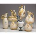 Royal worcester grouping of seven jugs three scroll handle no 1439 flatbottomed dragon handled no 1048 butterfly decorated jug with reticulated top rim tall ewer with green and brown enamelin