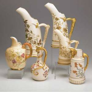 Royal worcester grouping of six jugs late 19th c three tusk jugs no 1116 mask spout jug no 1366 floral decorated jug no 1094 dragon handled jug tallest 11 14