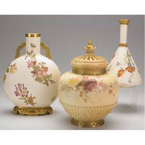 Royal worcester potpourri jar with reticulated cover pillow form vase with gilded base and handles and floral decorated vase with an overpainted base all late 19th c tallest 12