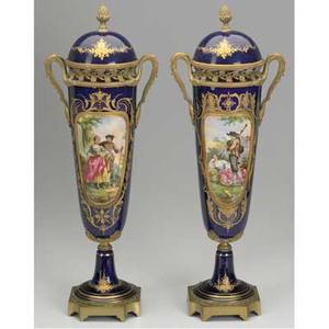 Sevres urns pair of gilt decorated and blue porcelain urns with lids bronze mounted with transfer decoration 20th c artist signed a robin sevres mark on inside of lid ht 20