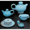 Beatrice wood earthenware teaset covered in blue volcanic glaze consisting of two teapots three teacups sugar dish and small cream pitcher all signed large teapot 7 x 10 12 x 7