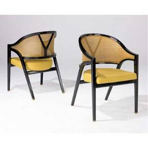 Edward wormley  dunbar pair of armchairs with caned backs the seats upholstered in gold fabric on ebonized wood bases dunbar metal tags 33 x 21 x 24