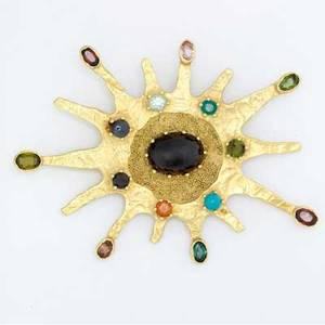 Ed wiener 18k yg gemstone pendantbrooch and chain with oval cabochon garnet and 14 bezel and prongset gemstone accents accompanied by a 22 12 textured link chain with granulation 631 gs tw