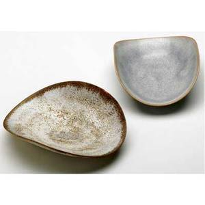 Natzler two small folded dishes one being an early piece covered in ivory crater glaze the other in gray mariposa glaze signed g  o natzler and natzler both 5 14