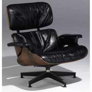 Charles and ray eames  herman miller 670 lounge chair in molded rosewood plywood upholstered in black leather on steel frame 33 x 33 12 x 30