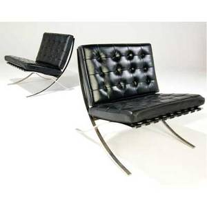Mies van der rohe  knoll pair of barcelona chairs with black leather cushions on polished steel frames provenance seagram building one seagram label 30 x 31 x 28