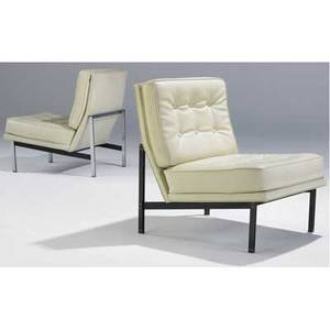 Knoll pair of lounge chairs upholstered in cream tufted leather on parallel bar steel frames one patinated 34 x 24 x 29