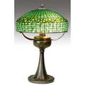 Tiffany studios table lamp with a lemonleaf shade in yellow and green leaded glass over a converted oilfont threesocket bronze base a few short breaks to glass fine original bronze patina shade