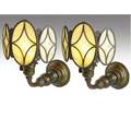 Tiffany studios pair of early bronze wall sconces with threepanel roped shields and yellow glass bases repatinated unmarked 12 x 10