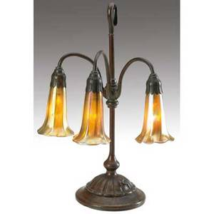 Tiffany studios threelight lily lamp with a fluted base ending in a hook complete with original switch original patina base stamped tiffany studios new york 306 shades etched lct favrile 17