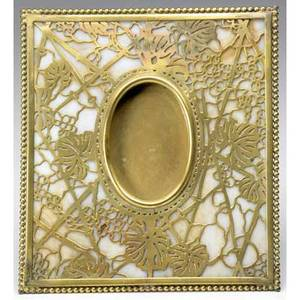 Tiffany studios tabletop picture frame in the grapevine pattern gold dore finish and caramel slag glass liner excellent original finish stamped tiffany studios new york 949 7 14 x 6 12