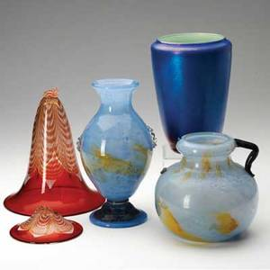 Durand four pieces two blue and yellow cluthra glass vases one flaring vase with pulled feather design brokenand one iridescent blue three marked tallest 9 12