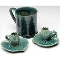 Chelsea keramic art works three items mug incised theresa with a frog inside and a pair of waterlilly candlesconces covered in teal blue glaze the leaves made from actual leaves dedham historical