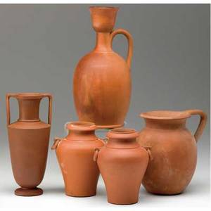 Chelsea keramic art works five bisquefired classicallyshaped vessels including a pair of urns with ring handles minor nick to shoulder of an urn each stamped ckaw tallest 8