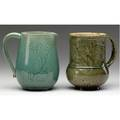 Chelsea keramic art works pitcher and mug carved with blossoms one covered in french blue glaze the other in olive green stamped ckaw 4 14 and 4 12