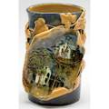 Chelsea keramic art works superlative vase with an applied tableau painted with two houses surrounded by ivy on a freeform vase in mottled blue glaze one of the very best and most unusual ckaw