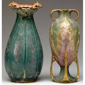 Amphora two vases the taller designed by paul dachsel with gold ladybugs on vermillion blossoms over an organic green and mauve base the other with two gilded handles and four buttressed legs mode
