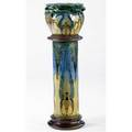 Barum ware tall and fine jardiniere and pedestal excised and enamelglazed with stylized peacocks complete with original stained wood base and fitting a few glaze flakes handincised ch brann