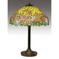 Unique tall table lamp with a leadedglass shade in a pink apple blossom pattern over a weighted spun metal foursocket brass base original a few minor indentations minor restoration to leading aro