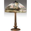 Handel table lamp with a chipped glass shade reversepainted with enamels depicting a moonlit landscape on a threesocket fluted bronzed base original patina base stamped handel shade stamped hand