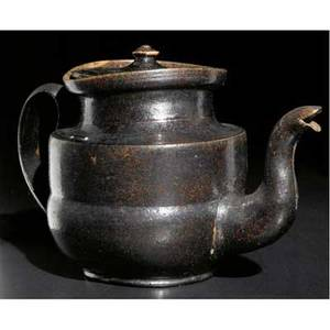 George ohr teapot with bulbous base covered in gunmetal brown glaze rim uneven dimple to base stamped geohr biloxi miss 6 x 8