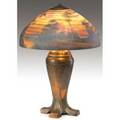 Handel table lamp with a chipped glass lobed shade reversepainted by hattie runge with a landscape covered with striated clouds at dusk worn copper patina shade stamped and signed handel 6534hr b