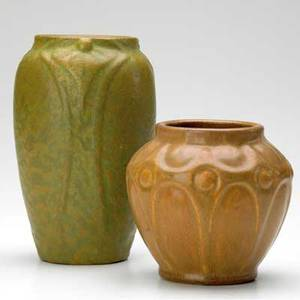 Van briggle two vases with stylized leaf designs one in frothy green and mustard glaze the other in brown minor abrasion to rim of larger larger marked aa van briggle colo spgs smaller unmarked