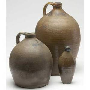 Stoneware two early 19th c ovoid jugs together with a flask tallest 17