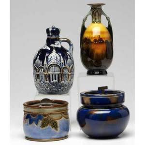 Assorted pottery four pieces two humidors one by royal doulton corked jug with asian decoration and music box bottom twohandled majolica ewer possibly german tallest 8