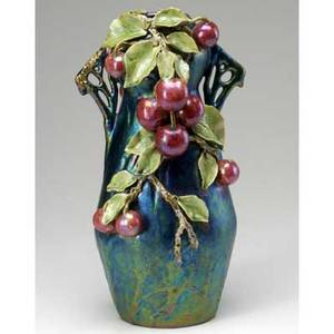 Style of teplitz iridescent vase with applied cherry leaf and vine decoration probably austrian 15