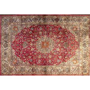 Persian mashed roomsize rug with a rich orange medallion and polychrome floral decoration on a ruby field ca 1970 99 x 1210
