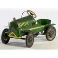 Childs steelpedal car with green paint yellow trim and rubber on steel wheels ca 19401950 22 x 36