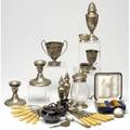 Silver and silverplate american and foreign silver and silverplated table items including salt and peppers candlesticks cups and demitasse spoons