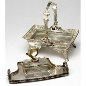Silverplated desk items secessionist style inkwell and guttapercha pen together with a silverplated handled basket with bird decoration basket with handle extended 12