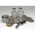 Silver and cutcrystal dresser set comprising two small scent bottles jar small tray brush and mirror missing one stopper
