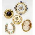 Gold brooches five brooches most in 14k yg include garnet and diamonds watch face with enameled pansies turquoise and seed pearl blue zircon 10k cameo brooch 545 gs