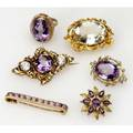 Gold and amethyst or rock crystal jewelry five brooches and a ring ca 18601920 three larger brooches and ring are 14k two smaller pinks are 10k 351 gs longest brooch measures 1 34