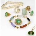 Gold jewelry in the asian taste ten pieces including jade pearls rubies demantoid diamonds four rings two bracelets two pendants and a brooch in 14k and an oval cabochon jade 24k ring