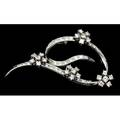 Diamond ribbon brooch abstract diamond set 14k wg ribbon accented by four floriform diamond clusters ca 1960 fine brilliantcut diamonds throughout approx 16 cts tw 67 gs 2 14