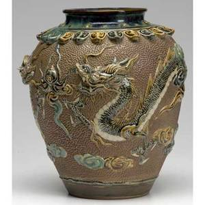 Chinese porcelain jar with dragon and lotus leaf relief design on flambe glaze 19th c 12 12