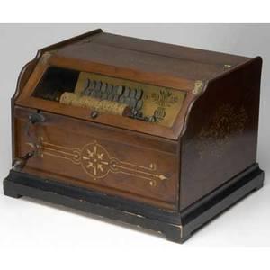 Concert roller organ in walnut case together with twenty interchangeable rolls ca 1875 17 x 12 x 15