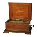 Stella doublecomb oak music box complete with thirtyfive 15 12 discs 12 x 27 x 21