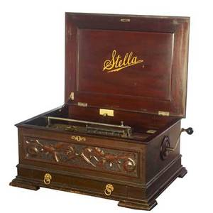 Stella mahogany cased music box complete with twenty 17 14 discs 13 14x x 29 14 x 22 14