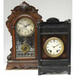 Early 20th c clocks seth thomas ebonized mantle clock together with a walnut gingerbread mantle clock tallest 18 34