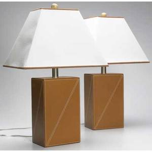 Modern pair of tan leather table lamps with white linen shades each 23 x 14 12 x 9